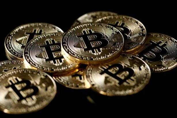 A collection of virtual currency bitcoin tokens are displayed in this picture illustration