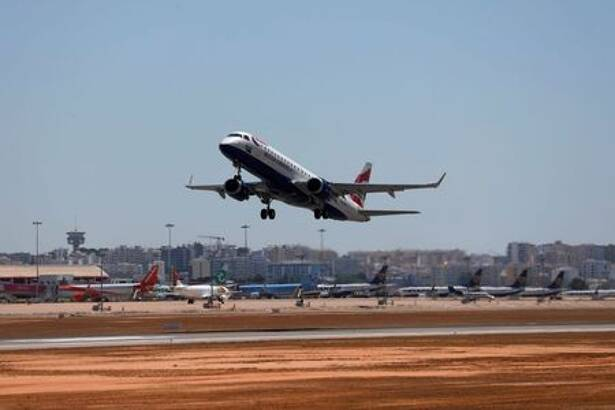 British Airways airplane takes off from Faro airport amid the
