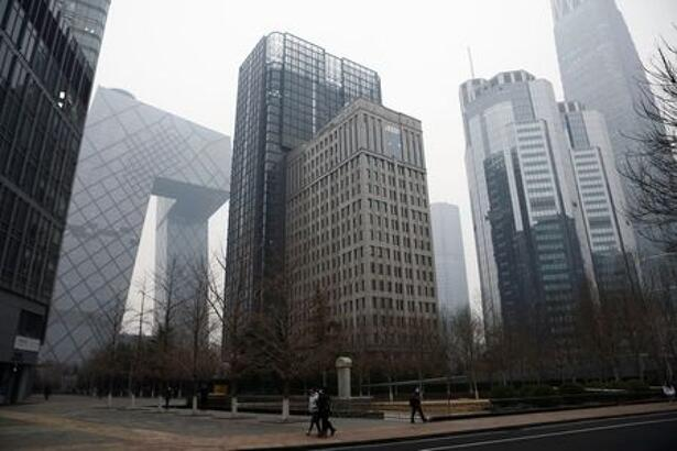 FILE PHOTO: People walk at the Beijing's central business district