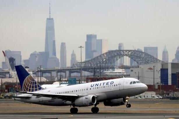 FILE PHOTO: A United Airlines passenger jet takes off with