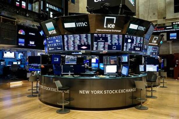 Floor traders work space is seen on the trading floor after the closing bell, following traders positive for Coronavirus disease (COVID-19), at the NYSE in New York
