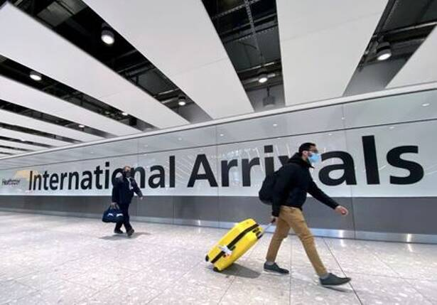 Travellers at Heathrow Airport