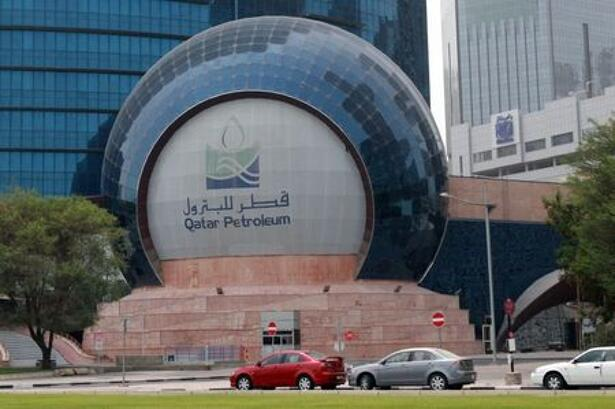 Cars are parked outside the headquartes of Qatar Petroleum in