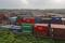 Cargo containers are seen stacked outside the container