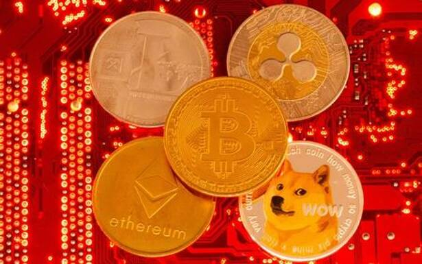 Representations of cryptocurrencies Bitcoin, Ethereum, DogeCoin, Ripple, Litecoin are placed on PC motherboard in this illustration taken