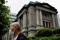 FILE PHOTO: A man stands in front of the headquarters of Bank of Japan