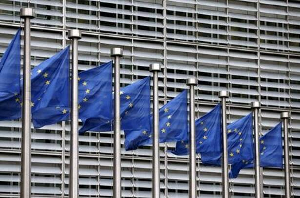 FILE PHOTO: Picture shows European Union flags fluttering outside the