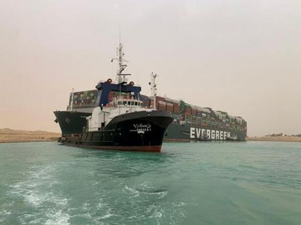 Container ship runs aground in Suez Canal, blocks