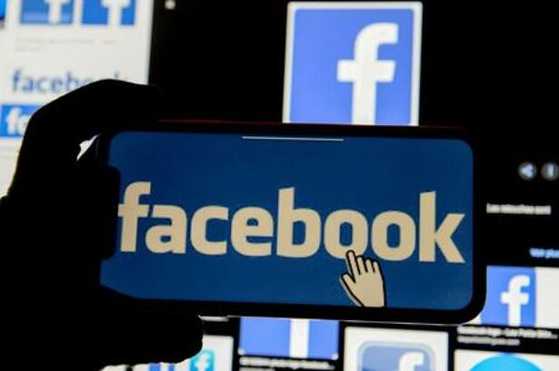 FILE PHOTO: The Facebook logo is displayed on a mobile