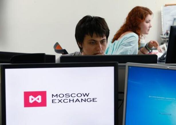 Employees work on the floor of the Moscow Exchange
