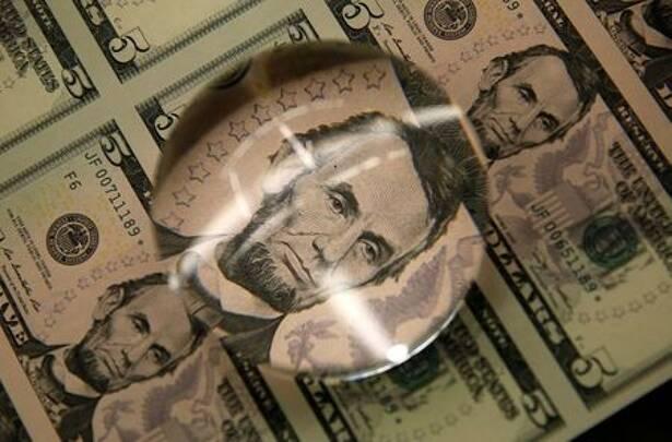 FILE PHOTO: FILE PHOTO: Sheets of Lincoln five dollar bill