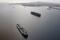 An oil tanker waits in line in the ocean outside