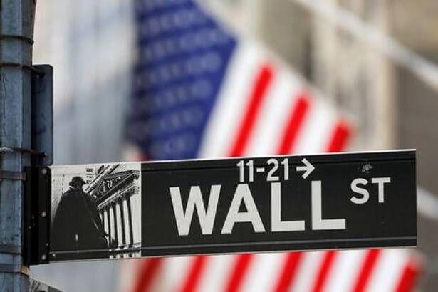 A street sign for Wall Street is seen outside the