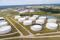 Crude oil storage tanks are seen in an aerial photograph