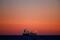 Oil tanker is seen at sunset anchored off the Fos-Lavera