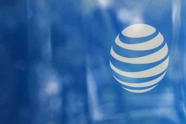 An AT&T logo is seen at an AT&T store in