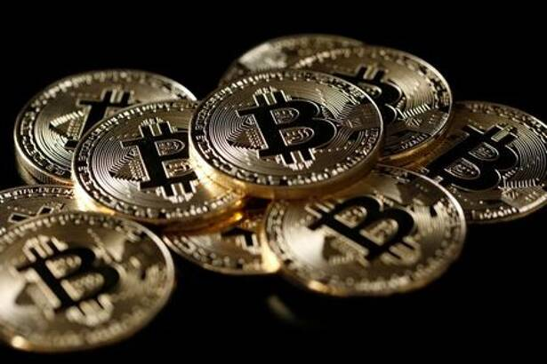 A collection of Bitcoin (virtual currency) tokens are displayed in